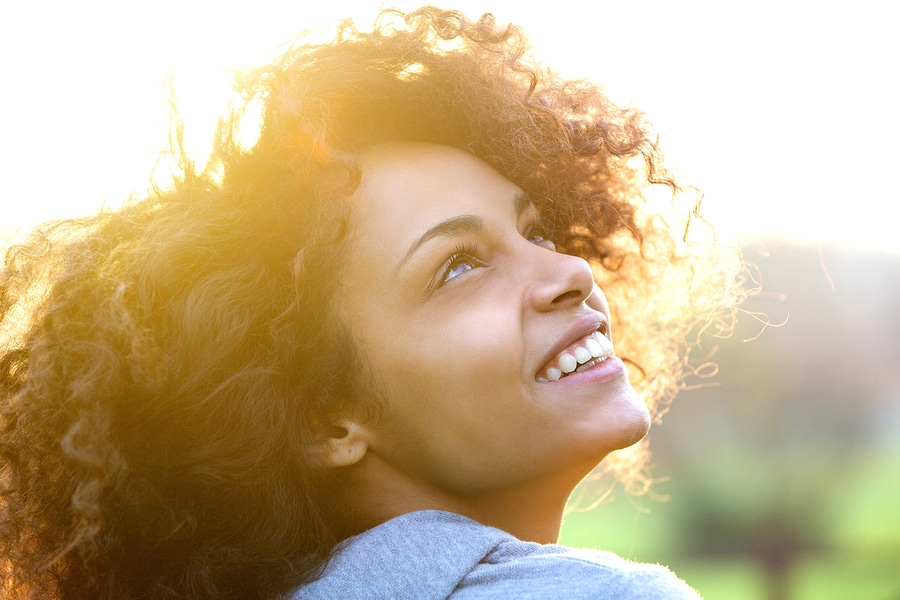 oung Woman in Sun Photo at Associated Orthodontrists