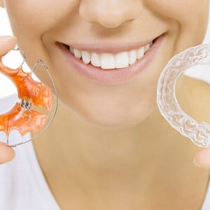 Woman with Retainers at Associated Orthodontists in Wausau Marshfield WI