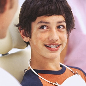 Seated Boy Patient Photo at Associated Orthodontists in Wausau Marshfield WI